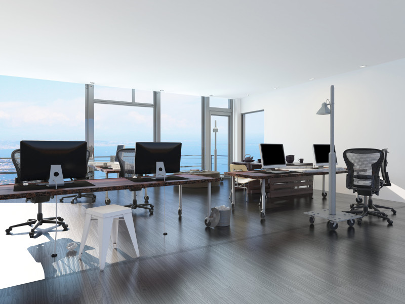 Modern waterfront office overlooking the sea with several comput